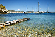 Spain, Ibiza, Jetty in bay with sailing boats - KIJF01016