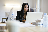 Young Asian woman working in office using laptop - EBSF01910
