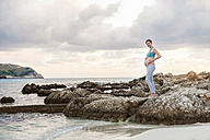 Pregnant woman standing at the sea - DIGF01462