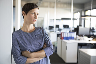 Businesswoman in office thinking - RBF05228