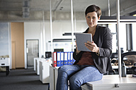 Businesswoman in office using tablet - RBF05240