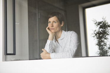 Woman looking out of window - RBF05273