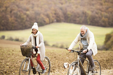 Senior couple doing a bicycle trip with dog - HAPF01167