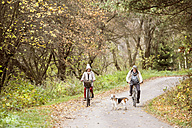 Senior couple doing a bicycle trip with dog - HAPF01173