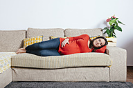 Pregnant woman sleeping on the couch - GEMF01298