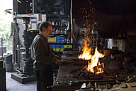 Blacksmith at work in his workshop - ABZF01578