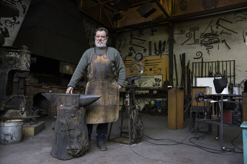 Portrait of confident blacksmith in his workshop - ABZF01590