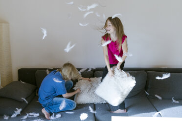 Pillow fight between brother and sister at home - SARF03083