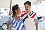 Smiling couple on a boat trip - WESTF22204