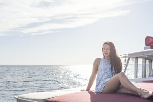 Young woman sitting on a boat - WESTF22228