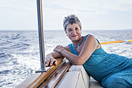 Smiling woman on a boat trip - WESTF22246