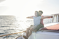 Happy young couple on a boat trip - WESTF22258