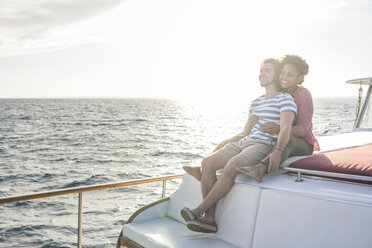Happy young couple on a boat trip - WESTF22261
