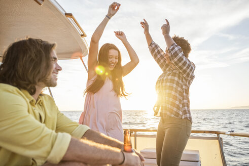 Happy friends having a party on a boat trip - WESTF22276