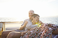 Affectionate couple on a boat trip at sunset - WESTF22294