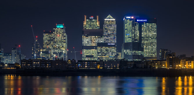 UK, London, Skyline of Canary Wharf at night as seen from North Greenwich - MPAF00106