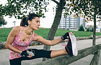 Woman stretching in a park - DAPF00508