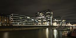 Germany, Cologne, Rheinau harbour with Crane Houses and marina by night - ODF01467