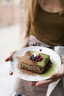 Woman preparing vegan matcha cake - VABF00892