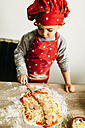 Little boy preparing pizza at home - JRFF01087