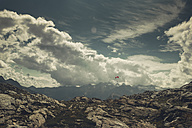 Italy, Lombardy, alpine panorama with paraglider - DWIF00813