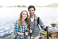 Young couple on a hiking tour at a lake - HAPF01179