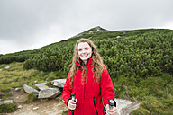 Portrait of smiling young woman on a hiking tour - HAPF01197