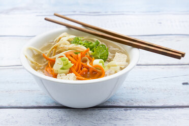 Bowl of miso soup with organic tofu, carrot noodles, parsnip, leek, glass noodles and parsley - LVF05703