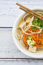Bowl of miso soup with organic tofu, carrot noodles, parsnip, leek, glass noodles and parsley - LVF05706