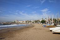 Spain, Catalonia, Sitges, coastal town and beach at Mediterranean Sea - ABOF00140