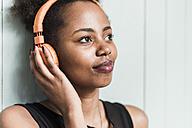 Young woman wearing headphones - UUF09514