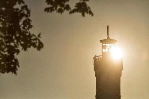 Germany, Lindau, Lake Constance, silhouette of lighthouse at sunrise - SHF01923