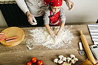 Father and son preparing pizza together - JRFF01099