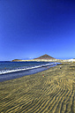 Spain, Tenerife, El Medano beach with Montana Roja in the distance - DSGF01301
