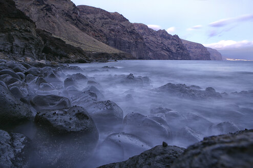 Spain, Tenerife, Evening view of Gigantes cliffs and ocean - DSGF01328