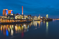 Germany, Frankfurt, view to lighted cogeneration plant and skyline - KEB00436