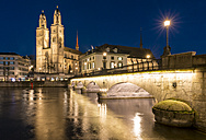 Switzerland, Zurich, view to Great Minster and Muenster Bridge at night - KEBF00447