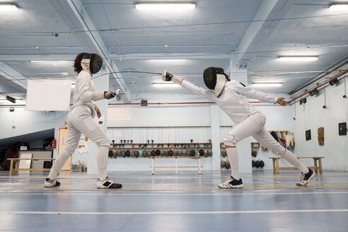 Female fencers during a fencing match - ABZF01615