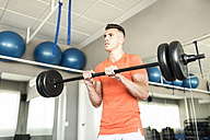 Man training triceps with bar - JASF01371