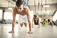 People doing suspension training in gym - JASF01377