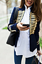 Fashionable young woman using cell phone - VABF00917