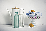 Still life with coffee pot, glass bottles, bowl, towel and lemons - VTF00578