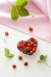 Heart-shaped bowl of wild strawberries - BRF01413