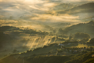 Italy, Marche, Apennines, aerial view of valleys with fog at sunrise - LOMF00457