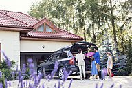 Happy family packing car for vacation - WEST22330