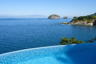 Mexico, Puerto Vallarta, Ocean front infinity swimming pool with view at Los Arcos National Marine Park - ABAF02108