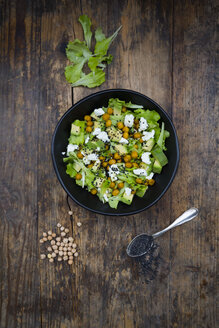 Bowl of leaf salad with roasted chick-peas, avocado, feta and black sesame - LVF05714