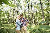 Senior couple watching something in the woods - HAPF01248