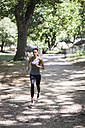Woman running in park - GIOF01694