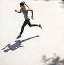 Top view of woman running - GIOF01703